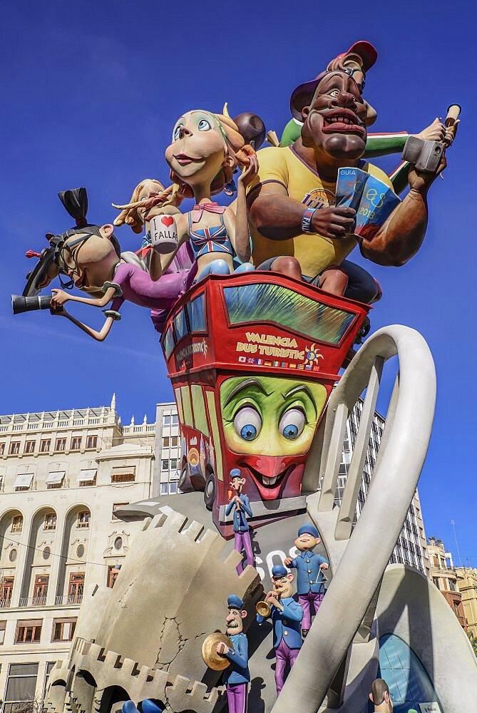 Spain, Valencia Province, Valencia, Las Fallas scene with Papier Mache figures on a Bus Turistic in Plaza Ayuntamiento during Las Fallas festival.