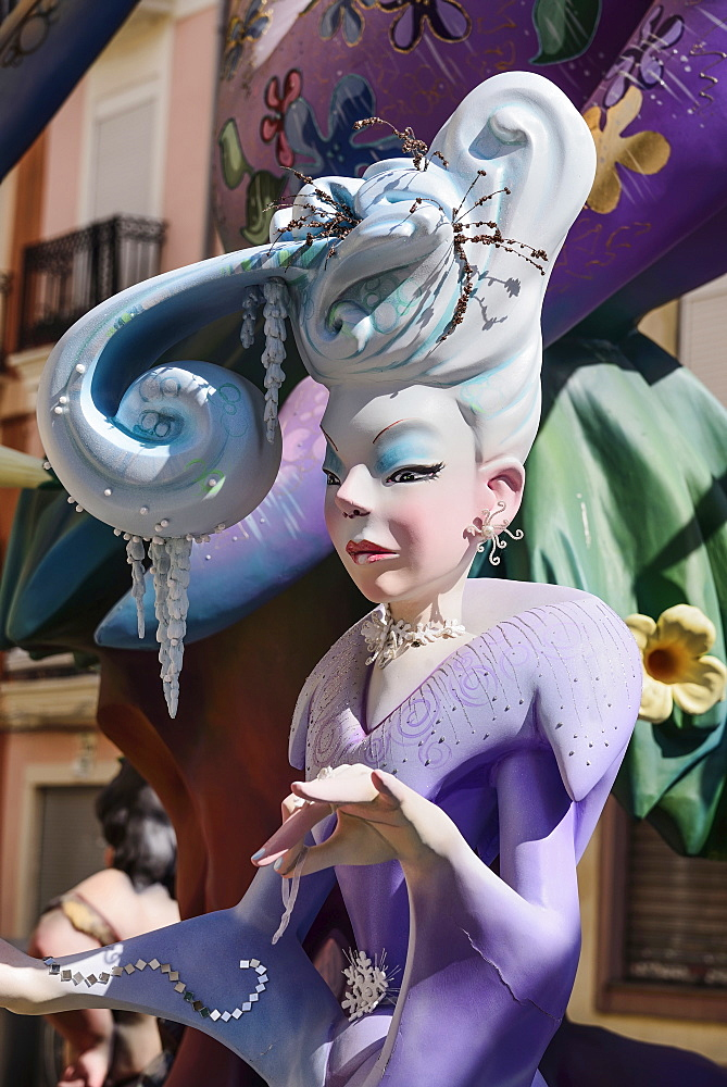 Spain, Valencia Province, Valencia, Papier Mache figure of well dressed lady in the street during Las Fallas festival.