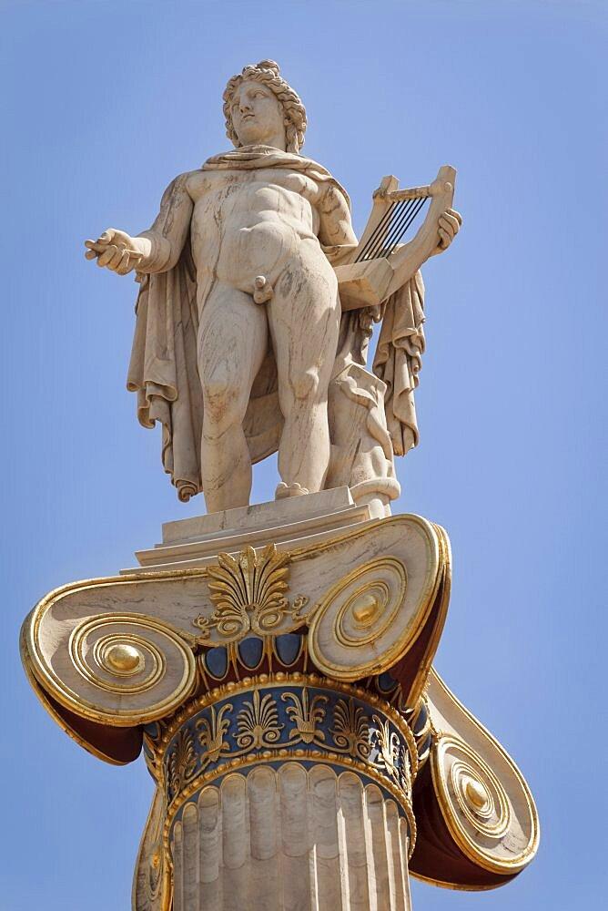 Greece, Attica, Athens, Statue of Apollo outside the Academy of Arts.