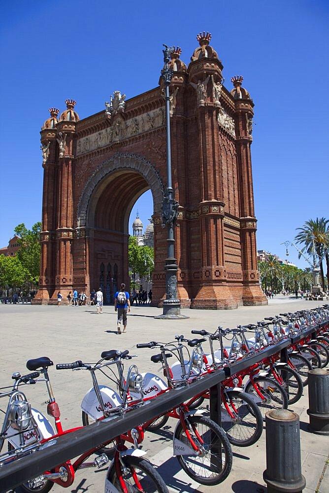 Spain, Catalonia, Barcelona, Parc de la Ciutadella, public hire bicycles next to Arc de Triomf.