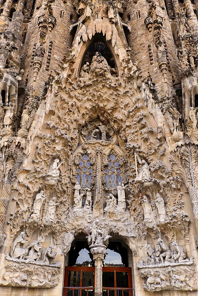 Spain, Catalunya, Barcelona, Basilica i Temple Expiatori de la Sagrada Familia, Generally known as Sagrada Familia, The Nativity facade showing the original detailed work of Antoni Gaudi.