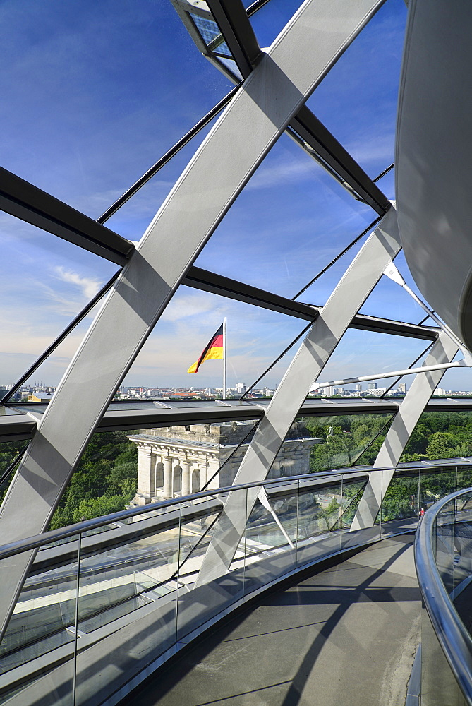 Germany, Berlin, Reichstag Parliament Building, Interior view of the Glass Dome designed by Norman Foster with German flag visible outside.