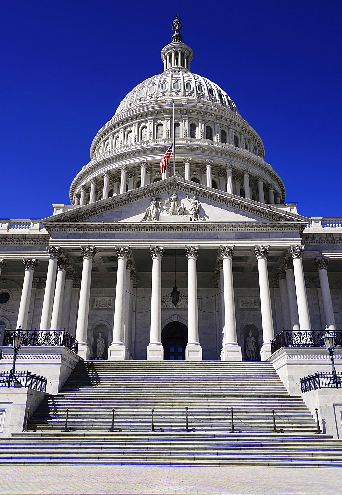 USA, Washington DC, Capitol Building, Head on view of the central section with its dome and American flag at half mast.