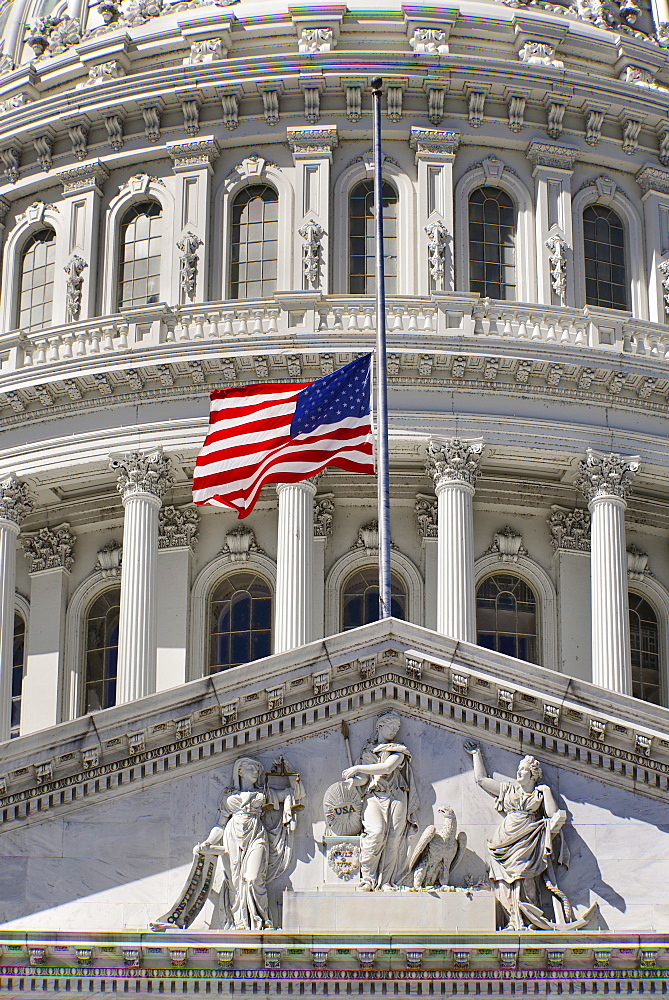 USA, Washington DC, Capitol Building, Section of the building's dome with the American flag at half mast.