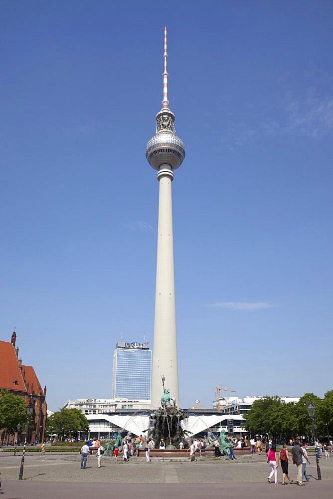 Germany, Berlin, Mitte, Fernsehturm TV Tower seen from St Marienkirche and Neptunbrunnen in Alexanderplatz.