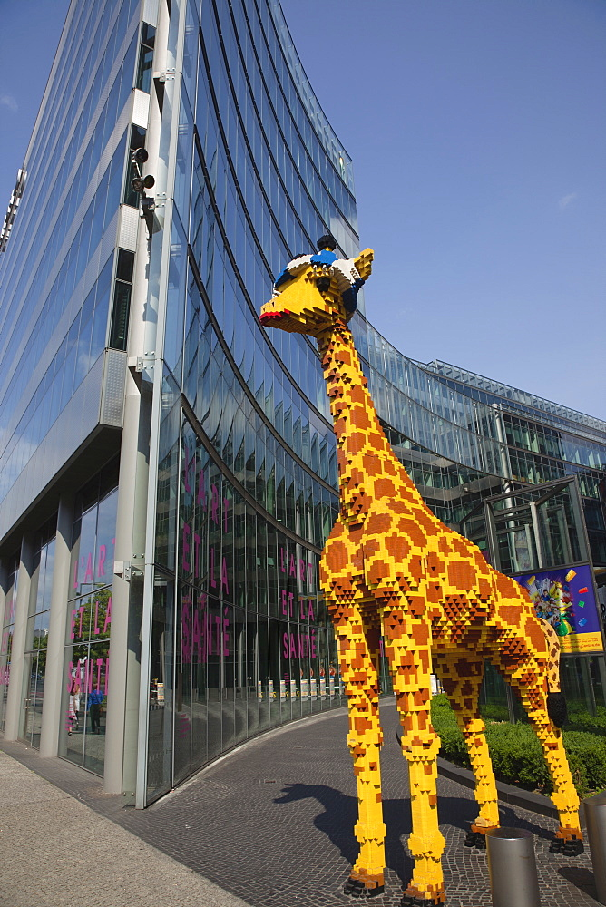 Germany, Berlin, Mitte, Potsdamer Platz, Model of Giraffe outside the Legoland Discovery Centre.
