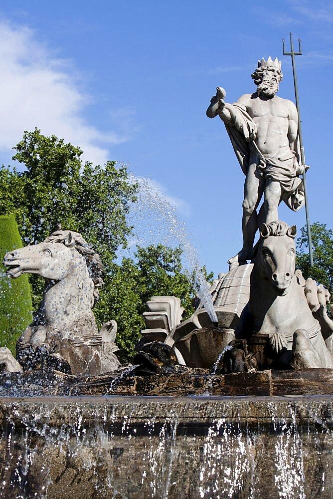 Spain, Madrid, The Fountain of Neptune at the Plaza de Canovas del Castillo.