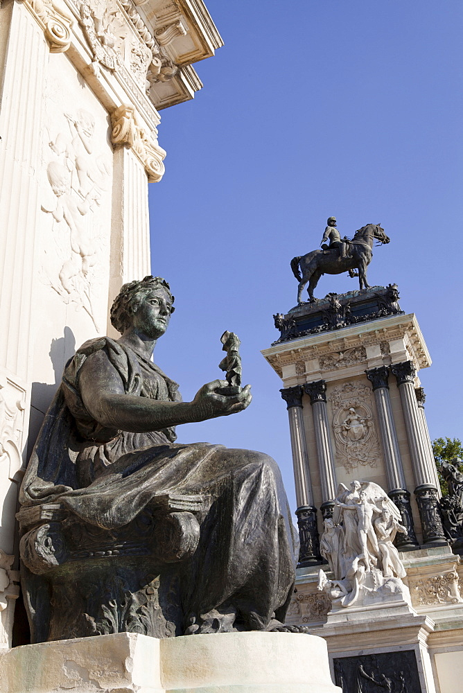Spain, Madrid, Statue on the monument to Alfonso XII at the Retiro.