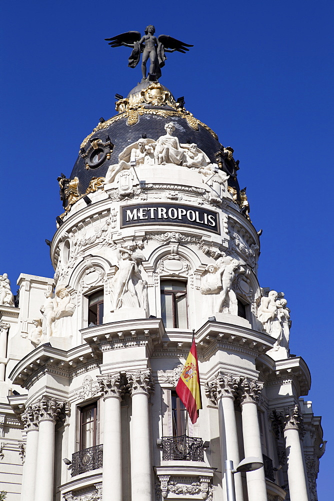 Spain, Madrid, Metropolis Building on Alcala Grand Via junction.