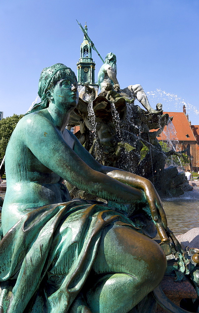 Germany, Berlin, Mitte, The Neptune Fountain or Neptunbrunner by Reinhold Begas dated 1891 with a female statue representing the Elbe one of the four main rivers of Prussia beside Marienkirche St Mary's Church.