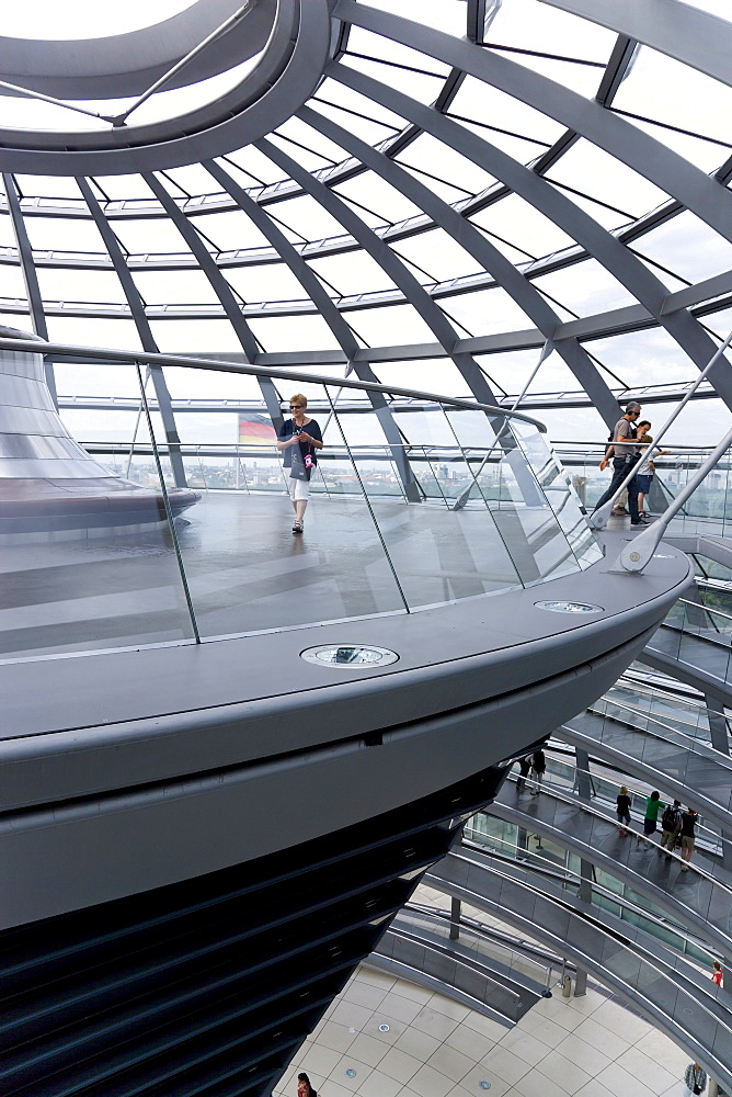 Germany, Berlin, Mitte, Tiergarten, interior of the glass dome on the top of the Reichstag building designed by architect Norman Foster with a double-helix spiral ramp around the mirrored cone that reflect light into the debating chamber of the Bundestag below. The top of the ramp here has the hot air vent from the debating chamber.