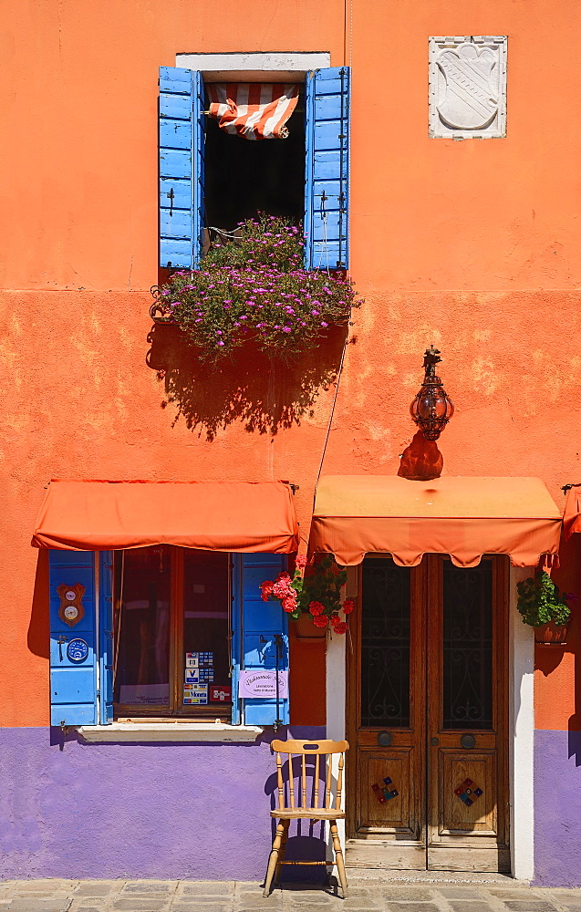 Italy, Veneto, Burano Island, Colourful row of house facades.