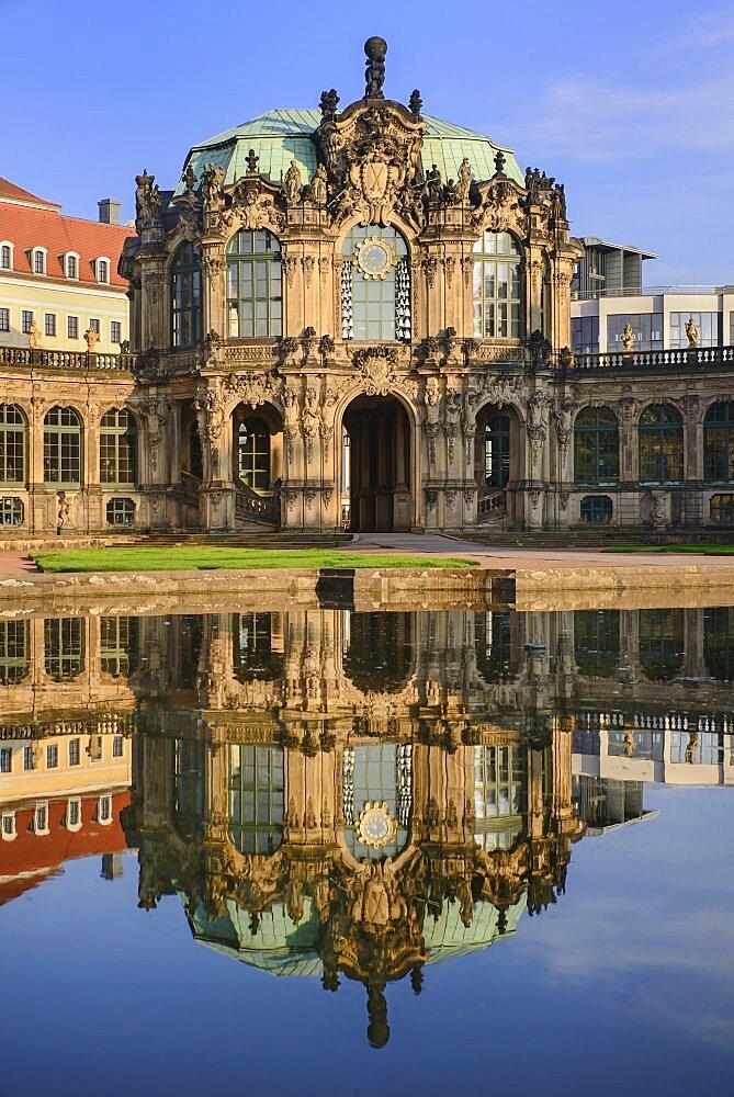 Germany, Saxony, Dresden, Zwinger Palace, Glockenspiel Pavilion reflected in pool.