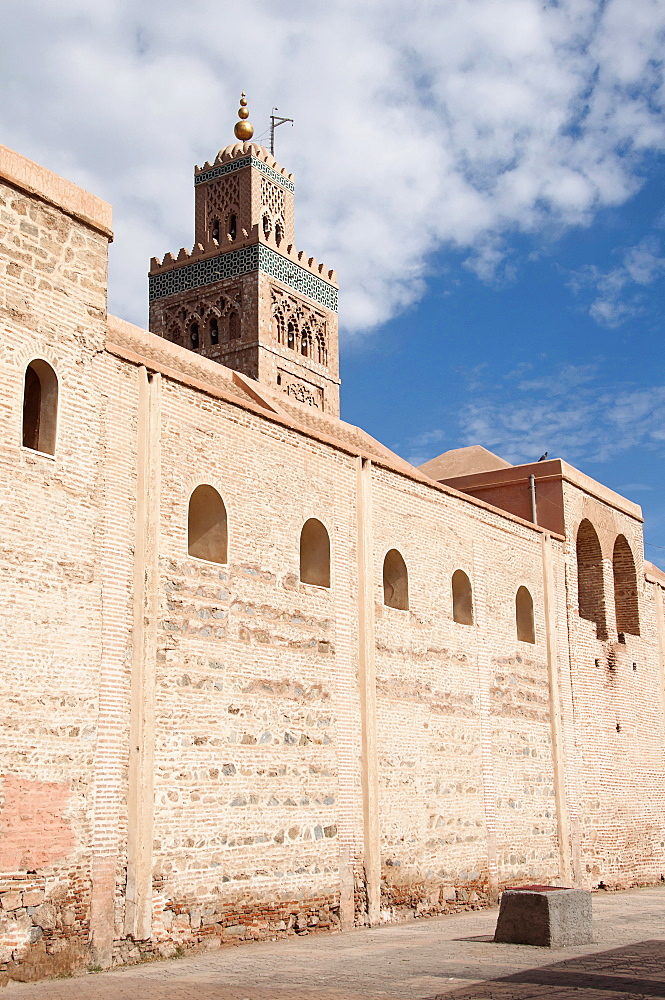 Morocco, Marrakech, Koutoubia Mosque behind old city walls.