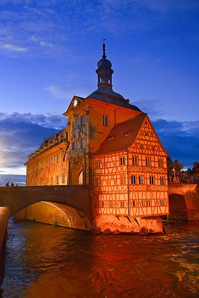 Germany, Bavaria, Bamberg, Altes Rathaus or Old Town Hall, Floodlit at dusk.