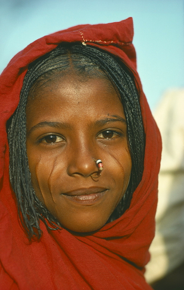SUDAN  Tribal People Portrait of a young Eritrean woman with scarified cheeks and a nose ring
