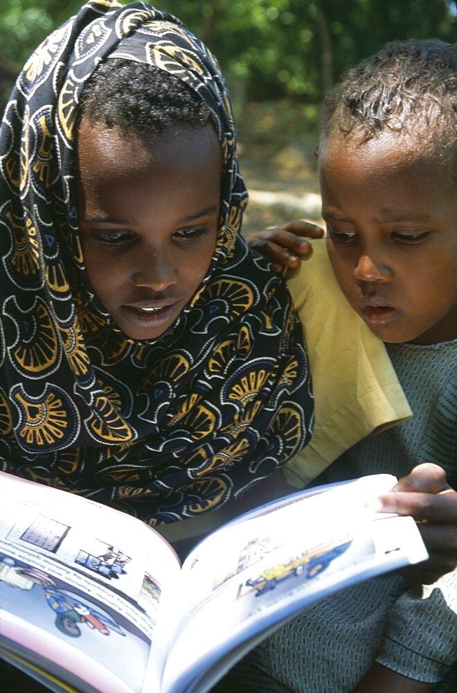 SOMALIA  Habare Village Children using new Somali textbooks produced by Unicef.