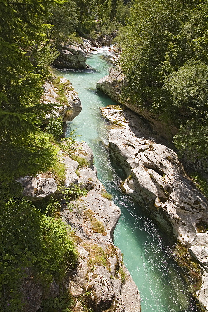 SLOVENIA  Trenta Valley Soca River Viewed from Felika Korita Soce a narrow wooden suspension bridge  flowing through rocks shaped by the power of the water   Clear blue water narrow gorge limestone rocks clean water important river