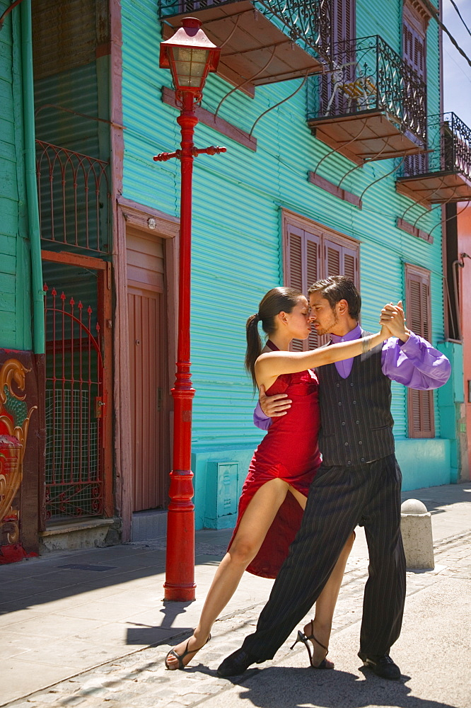 ARGENTINA  Buenos Aires Close-up of tango dancers in La Boca. Model Release Available La Boca Buenos Aires dance couple intimate Travel tango Latin America South America Argentina American Argentinian Hispanic Latino