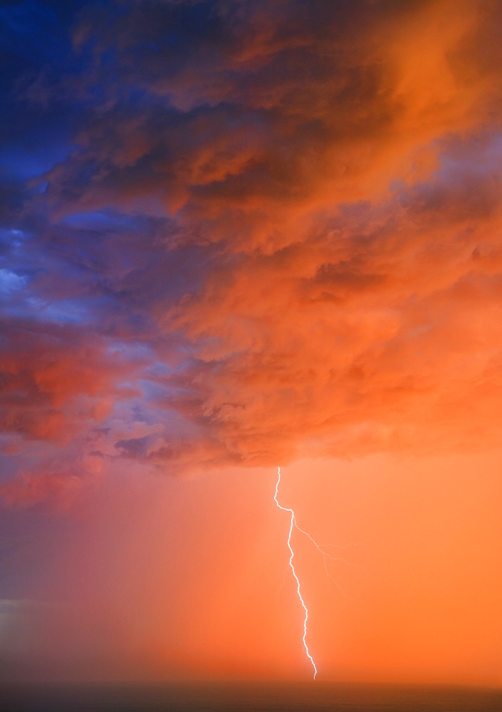 Bolt of lightening at sunset, Wild Coast, Eastern Cape, South Africa