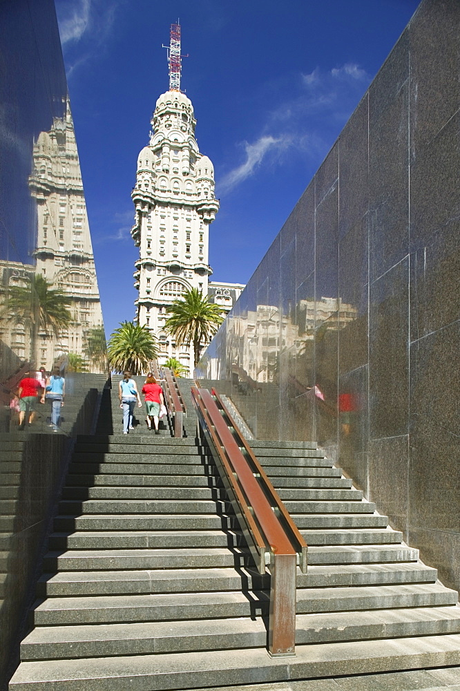 URUGUAY  Montevideo Steps rising up from Jose G Artigas mausoleum in Plaza Independencia with Palacio Salvo behind. Landmark Palacio Salvo Montevideo Holidays Tourism Travel South America Uruguay Latin America Artigas American Hispanic Latino Gray Grey   - 797-3877
