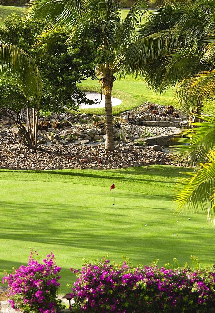 Raffles Resort Trump International Golf Course designed by Jim Fazio, The practice green, Canouan, St Vincent & The Grenadines