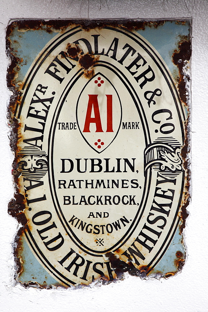 Cathedral Quarter Commerical Court Old metal whiskey sign decorating the exterior of the Duke of York Public House, Northern Ireland