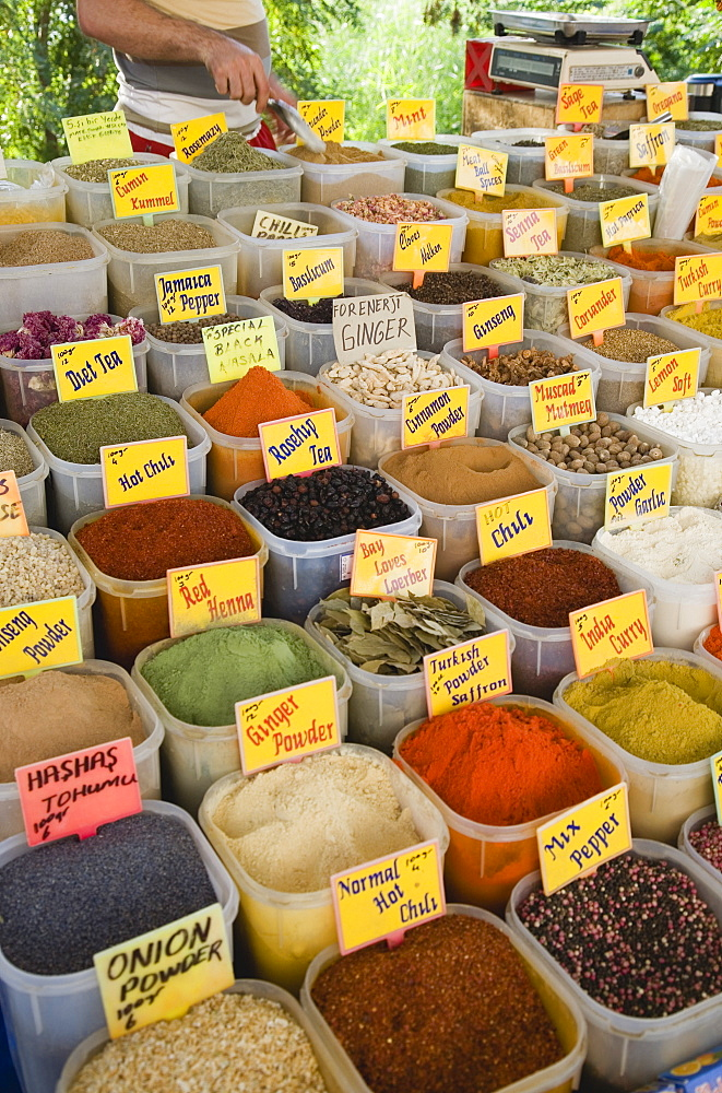 Turkey, Aydin Province, Kusadasi, Satll at weekly market selling spices and chili powders in brightly coloured display