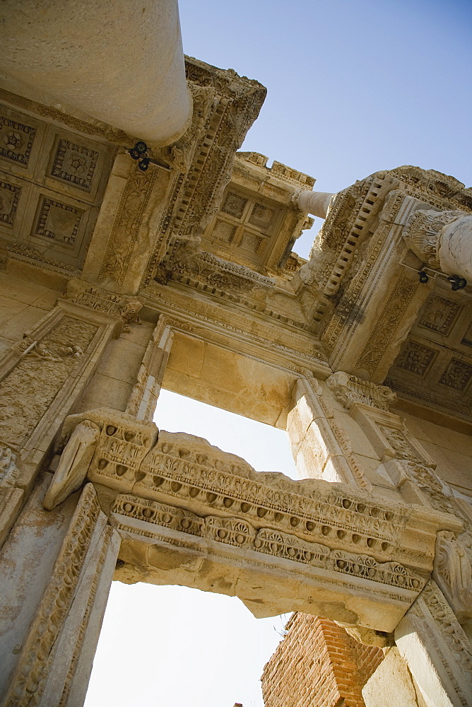 Turkey, Izmir Province, Selcuk, Ephesus, Roman Library of Celsus facade Angled view looking up at decoratively carved roof and doorway