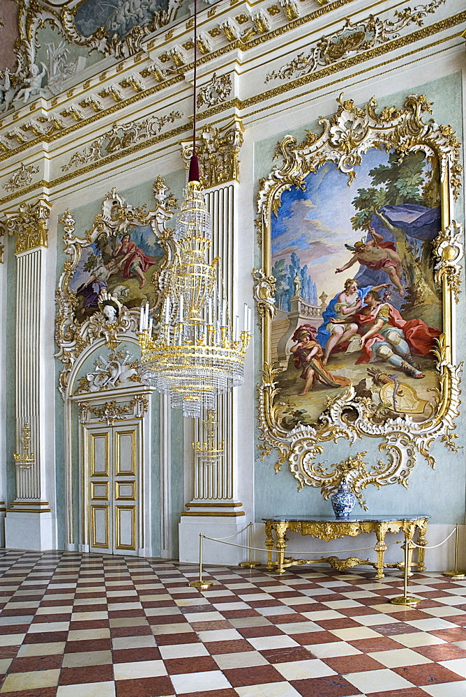 Germany, Bavaria, Munich, Nymphenburg Palace. Interior of Steinerner Saal the Stone or Great Hall with detail of paintings red and white chequered floor and gold and white baroque decoration by Francois de Cuvillies.