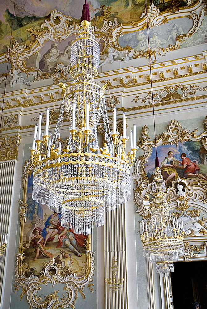 Germany, Bavaria, Munich, Nymphenburg Palace. Interior of Steinerner Saal the Stone or Great Hall with detail of paintings elaborate chandelier and gold and white baroque decoration by Francois de Cuvillies.