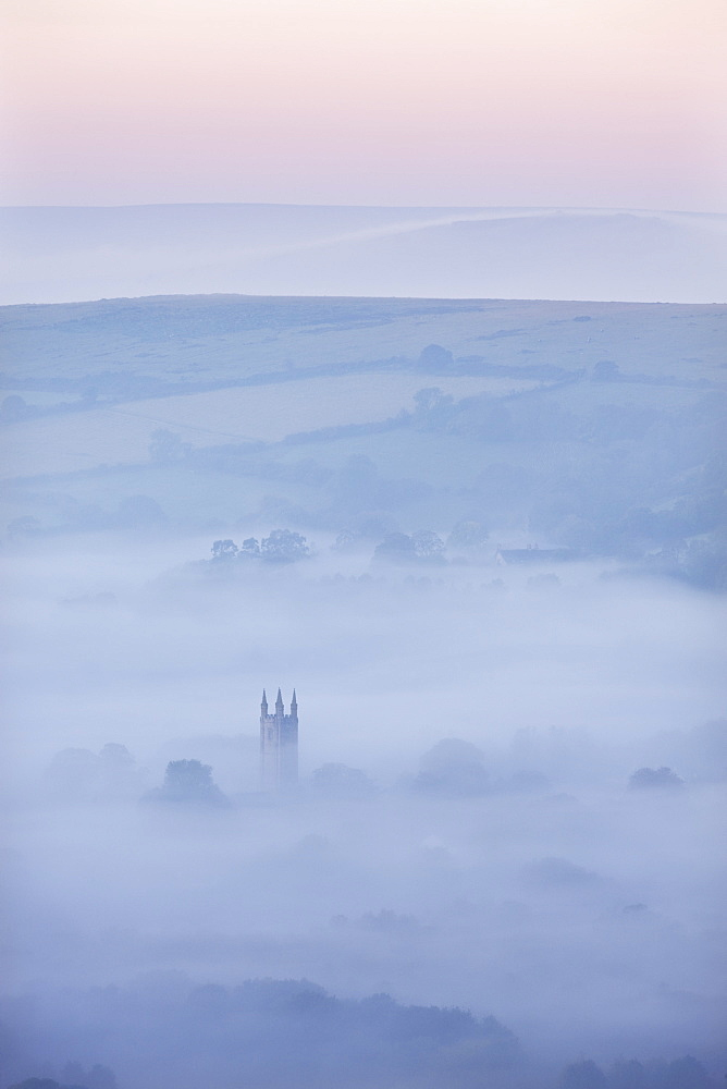 Widecombe-in-the-Moor Church surrounded by mist at dawn, Dartmoor National Park, Devon, England, United Kingdom, Europe - 799-1634
