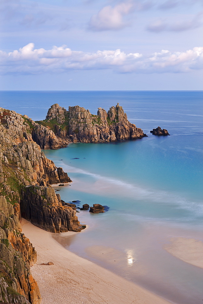 Pednvounder Beach and Logan Rock from the clifftops near Treen, Porthcurno, Cornwall, England, United Kingdom, Europe