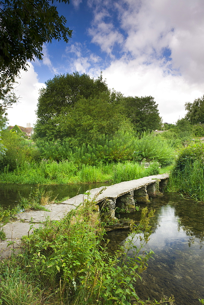 Stone clapper bridge over the River Leach at Eastleach Turville in the Cotswolds, Gloucestershire, England, United Kingdom, Europe