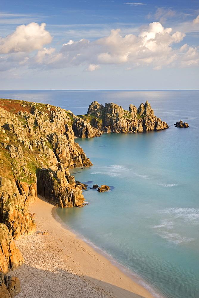 Pednvounder Beach backed by Logan Rock on Treryn Dinas headland, Porthcurno, Cornwall, England, United Kingdom, Europe
