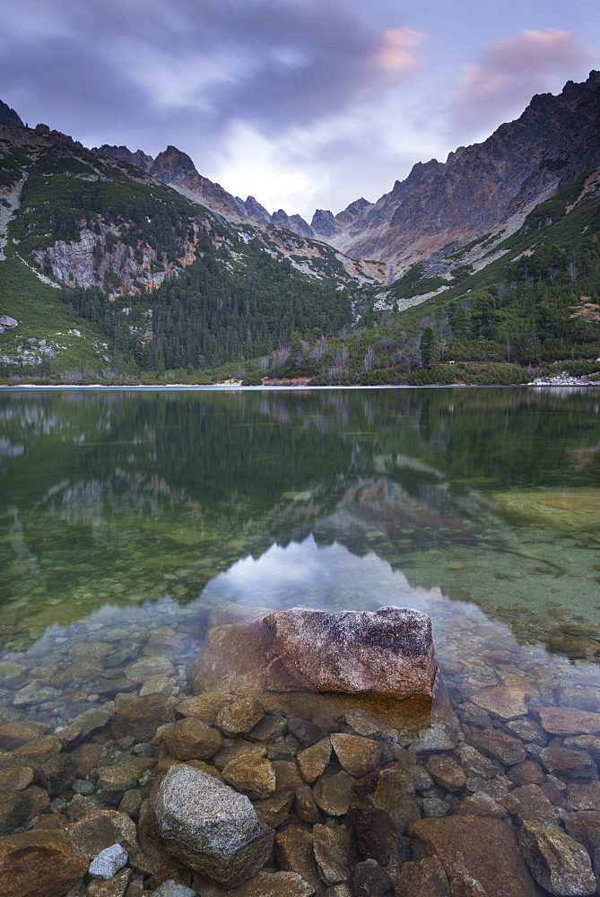 A mirror still Popradske Pleso lake in the High Tatras, Tatra Mountains, Slovakia, Europe