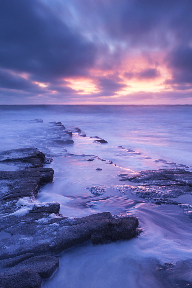 Dramatic sunset above Nash Point on the Glamorgan Heritage Coast, South Wales, Wales, United Kingdom, Europe