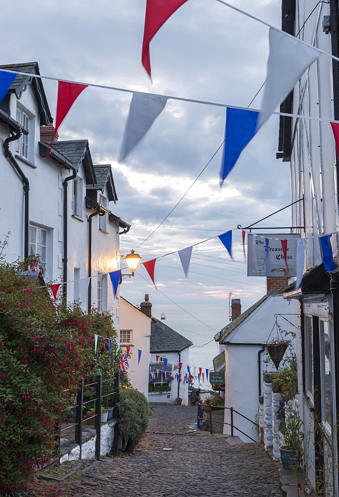 Bunting above the cobbled streets of Clovelly at dawn, North Devon, England, United Kingdom, Europe