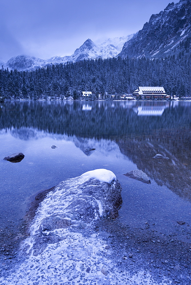 Popradske Pleso lake and mountain cottage in wintertime, Slovakia, Europe