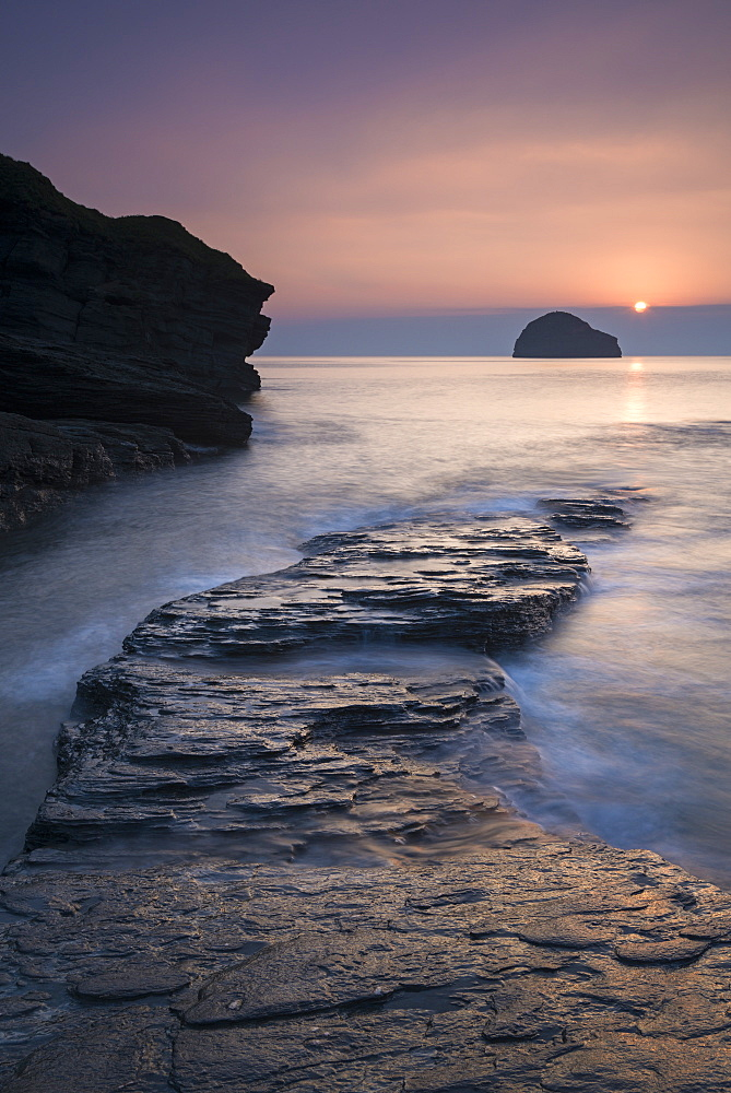 Sunset over Gull Rock from Trebarwith Strand, Cornwall, England, United Kingdom, Europe