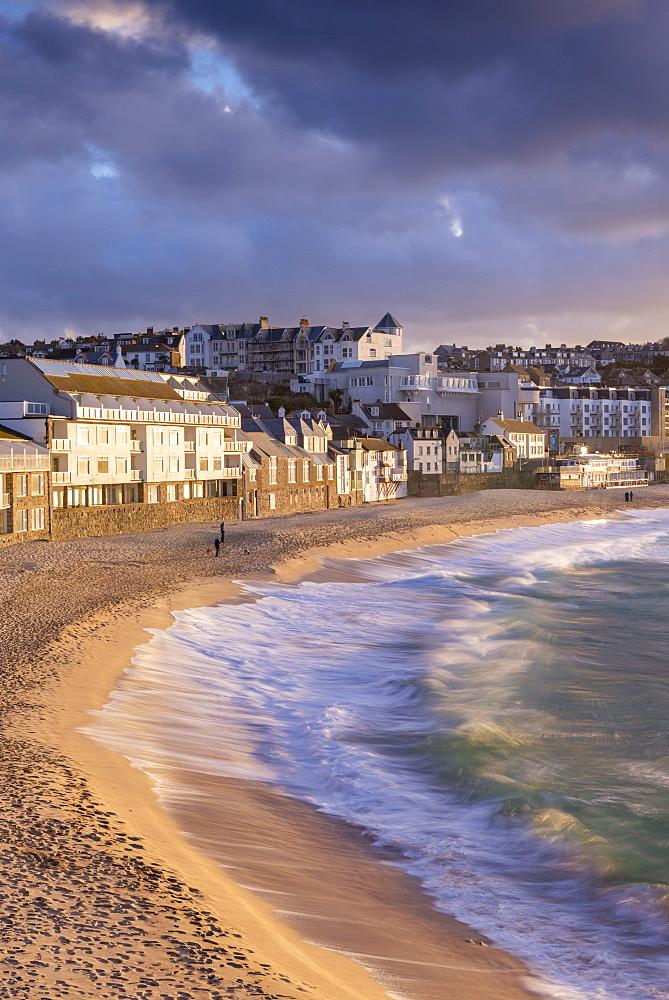 Waves crash against Porthmeor Beach in St. Ives, Cornwall, England, United Kingdom, Europe
