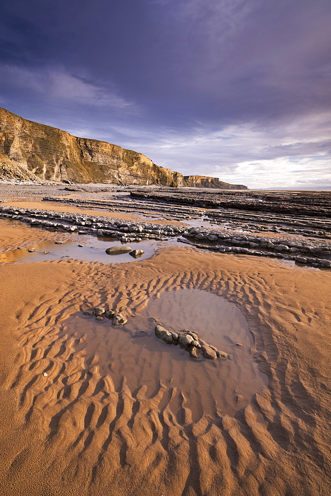 Tidal pools on the sandy beach near Dunraven Bay on the Glamorgan Coast, South Wales, Wales, United Kingdom, Europe
