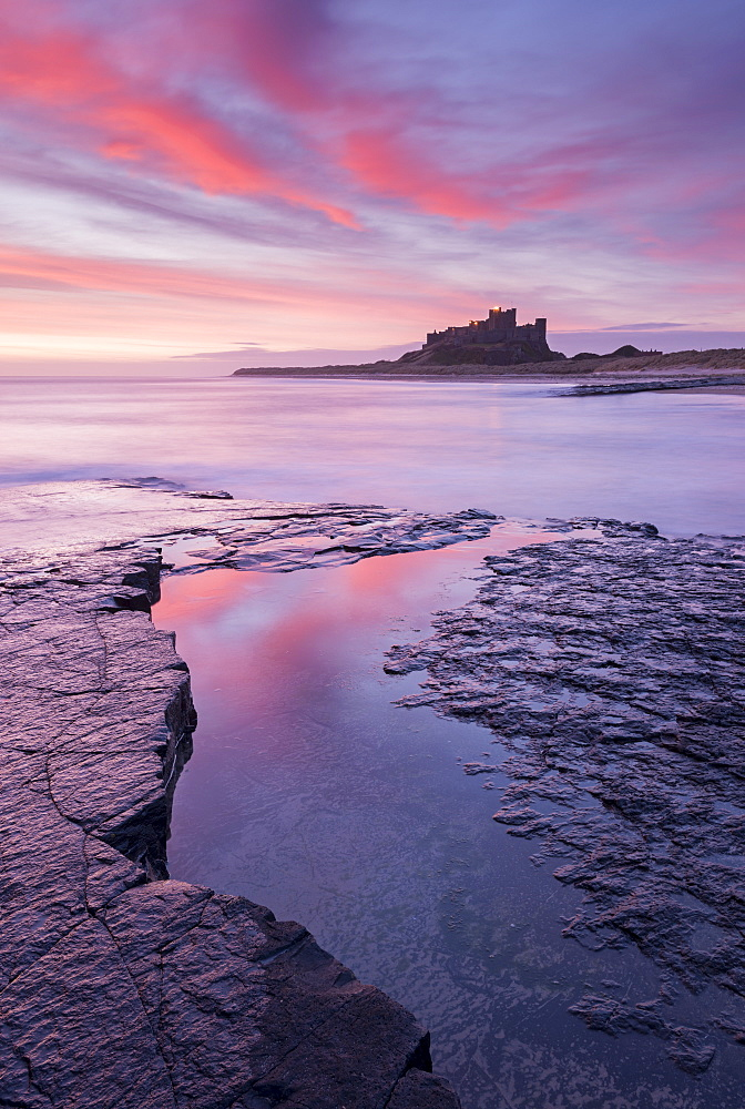 Sunrise over Bamburgh Castle on the Northumberland coast, Northumberland, England, United Kingdom, Europe - 799-3448