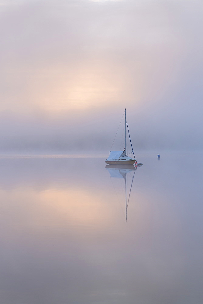 Sailing boat in misty conditions at dawn on Wimbleball Lake, Exmoor National Park, Somerset, England, United Kingdom, Europe - 799-3572