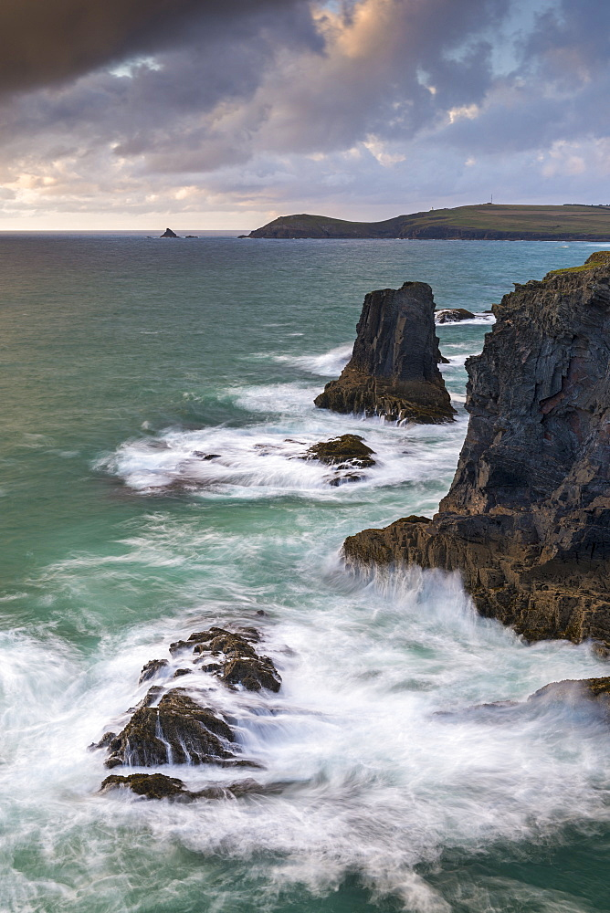 Waves crash over rock stacks near Treyarnon on the north coast of Cornwall, England, United Kingdom, Europe - 799-3669