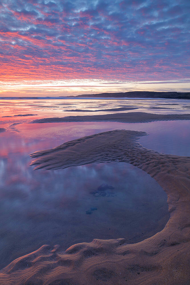 Beautiful sunset over the beach at Freshwater West in Pembrokeshire Coast National Park, Wales, United Kingdom, Europe