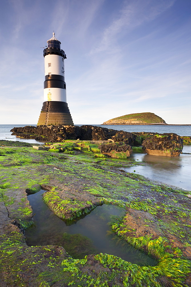 Penmon Point lighthouse and Puffin Island on the east coast of Anglesey, North Wales, Wales, United Kingdom, Europe
