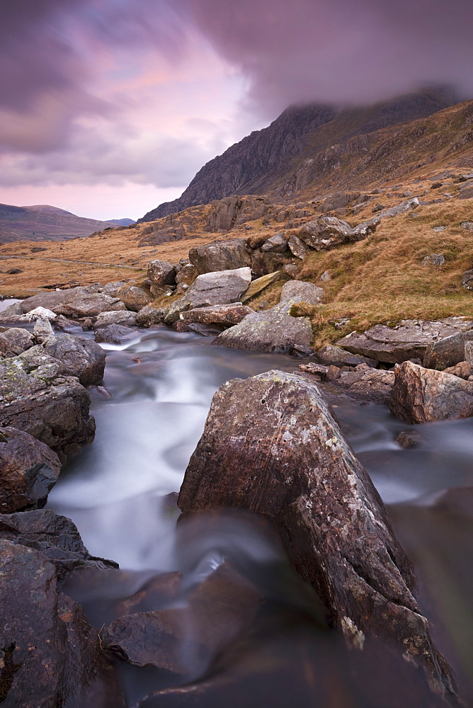 Rocky river in Cwm Idwal looking towards Tryfan at sunset, Snowdonia National Park, Conwy, Wales, United Kingdom, Europe