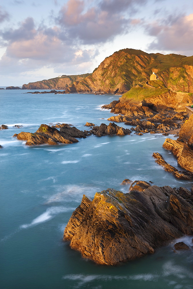 St. Nicholas Chapel and Beacon Point on the rocky coast of Ilfracombe, Devon, England, United Kingdom, Europe