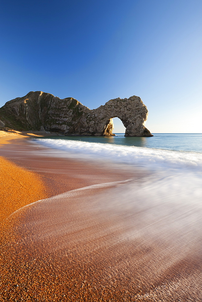 Waves break onto Durdle Door beach in winter, Jurassic Coast, UNESCO World Heritage Site, Dorset, England, United Kingdom, Europe